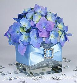Purple hydrangea centerpiece with ribbbon and rhinestone buckle accents. #wedding #centerpiece #reception