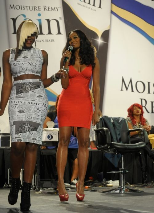 Cynthia Bailey looks awesome. I am also loving the hair and the outfit on the model.