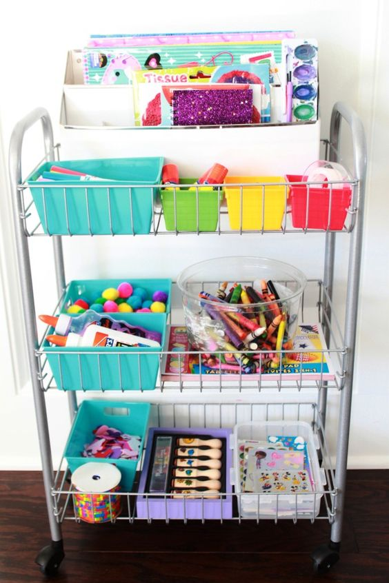 Make kid's art supplies accessible and mobile by keeping them in a rolling cart: