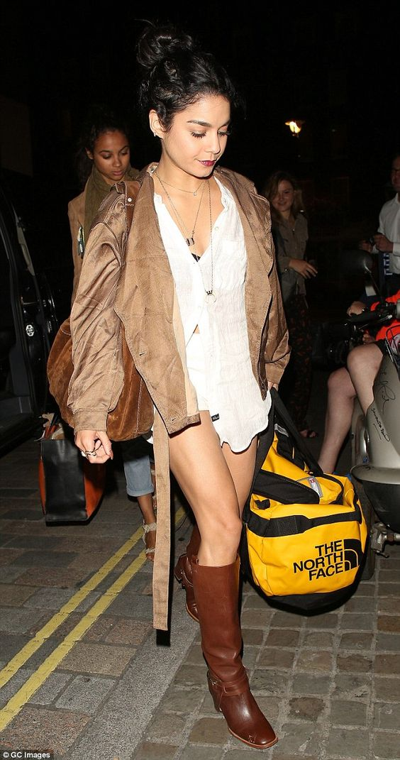 Night on the town: Vanessa Hudgens stepped out in a pair of white shorts and knee-high lea...