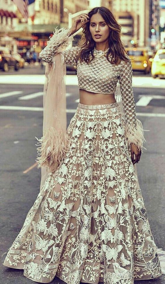 Bride Looking gorgeous pale peach lehenga with silver butterfly motifs | Wedding Reception Ideas | Reception Dress Ideas | Function Mania