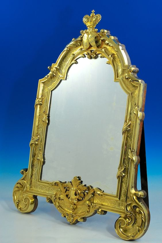 A magnificent French silver-gilt mounted toilet mirror. By Morel, Paris circa 1860.  32 inches high