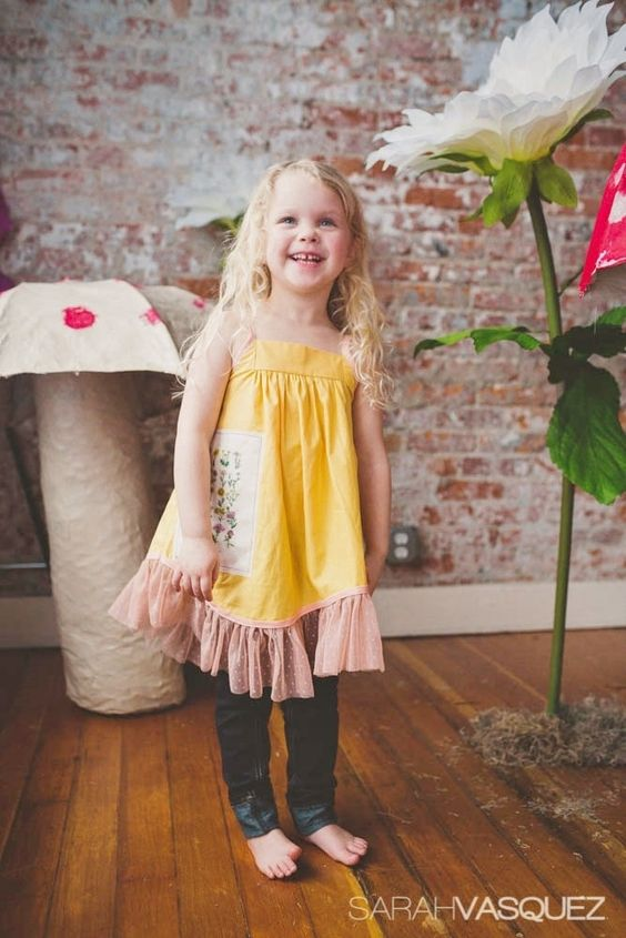 A bright happy yellow with peach trim and lace - this dress is sweet and unique, for her to wear through spring, summer and into the fall. Also works over longsleeve tees in the winter - straps are fully adjustable for longer wear.  Patch is a very vintage botanical illustration printed on fabr...