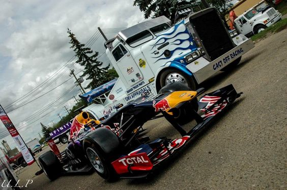 Diesel drag vehicle and red bulls race car