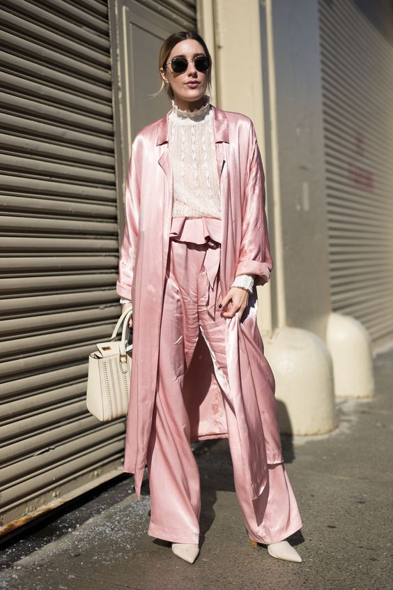 NEW YORK, NY - FEBRUARY 10: Caitlyn Warakomski is seen attending Hakan Akkaya/Concept Korea during New York Fashion Week wearing a silk pink outfit on February 10, 2017 in New York City. (Photo by Matthew Sperzel/Getty Images) via @AOL_Lifestyle Read more: https://www.aol.com/article/lifestyle/2017/02/12/the-best-street-style-from-days-2-and-3-of-new-york-fashion-week/21712263/?a_dgi=aolshare_pinterest#fullscreen