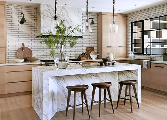 LOVE, need this island.  Also, love hood central with openness around hood, and then longer side cabinets.: