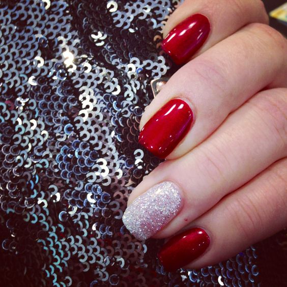 Red gel nails with silver rockstar glitter accent!: