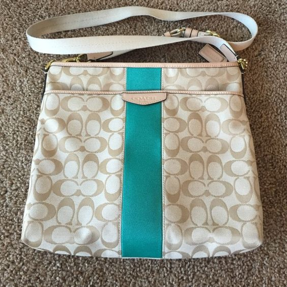 Coach cross body bag Cute cross body coach purse. I just never use it so looking to sell. Great condition on the outside and inside. The strap was stepped on once so there are marks on the strap as shown in picture but over all is a beautiful purse in great condition. Coach Bags Crossbody Bags