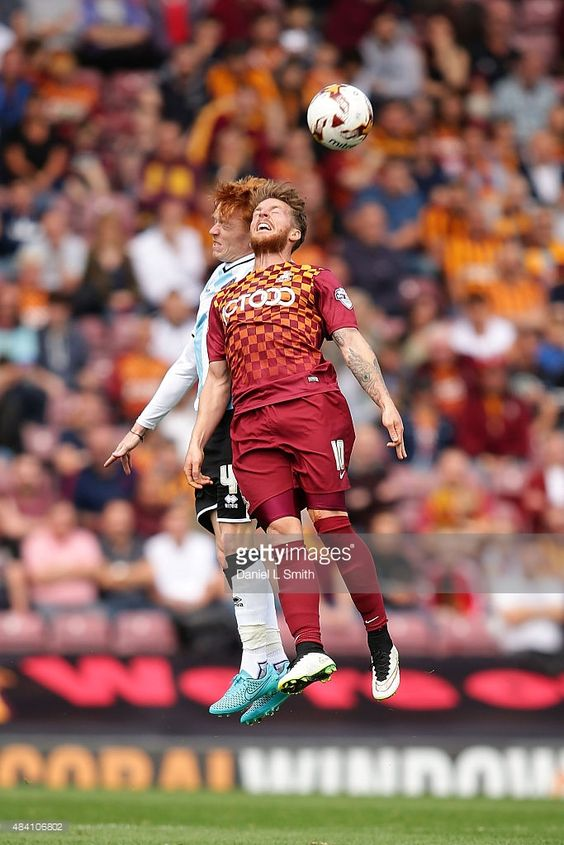 Ryan Woods of Shrewsbury Town FC and Billy Clarke of Bradford City AFC head the ball during the League One match between Bradford City AFC and Shrewsbury Town FC at Coral Windows Stadium, Valley Parade on August 15, 2015 in Bradford, England.