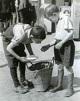 Boy with kindling in basement dwelling, Krochmalna Street, Warsaw