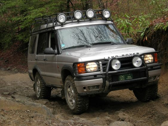 My favorite, the 2001 Land Rover Discovery II SE AWD V8 SUV (mine was Olso blue)... I'd still be driving it today probably if it wasn't for its horrendous gas mileage. When anarchy sets in this is the vehicle you want in your possession...
