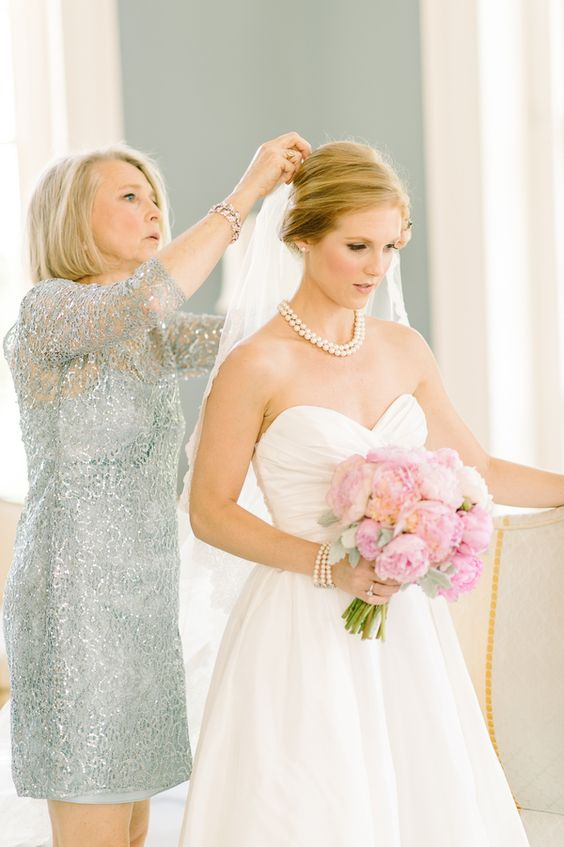 Definitely need a shot of the bride with her mother getting ready! | Photo by Dominique Attaway Photography