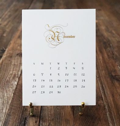 Our opulent Pen & Ink calendar with its swirling decadent typestyle, is jewelry for your desk. Bring elegance and order to your library, in-home office or executive suite.