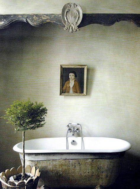 So much inspiration in today's French Country roundup including: Elegant simplicity in an magnificent Provencal, French Country bathroom with aged clawfoot tub and serene decor. #Provence #FrenchCountry