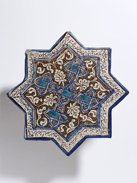Tile      Place of origin:      Kashan, Iran (made)     Tehran, Iran (excavated)     Date:      early 14th century (made)     Artist/Maker:      unknown (production)     Materials and Techniques:      Fritware, glazed and painted in turquoise, cobalt blue and lustre     Museum number:      1836-1876