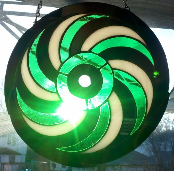 The spiral crop circle formation in sunlight.  The green glass has a texture of subtle lines inside of it.