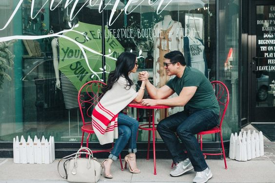 Fun idea for couples photos. A photo of you two arm wrestling! A great idea if you two are both the ambitious/competitive type.  On Her: Cupcakes and Cashmere striped poncho cardigan, distressed jeans and minimalist sandals.  On Him: J.Crew broken in tee, Hudson jeans and Nike Internationalist sneakers