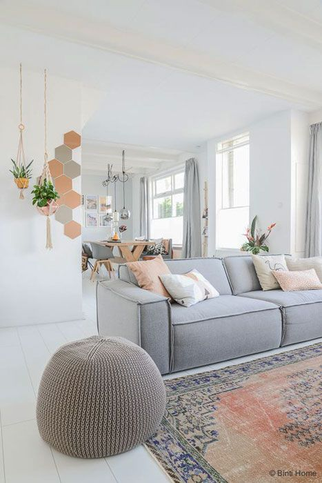 Love the contrast between the grey sofa and pink in the rug.: