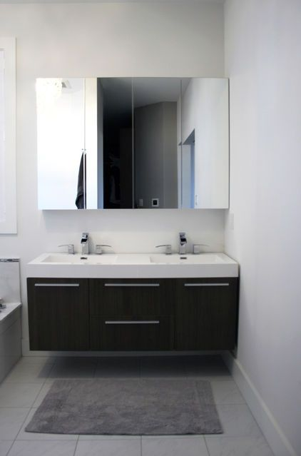 From houzz two ikea mirrored medicine cabinets are hung side by side above the floating vanity - Ikea floating bathroom vanity using kitchen cabinets ...