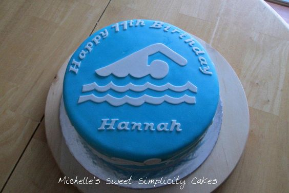 Swimming themed birthday cake featuring the four different swim strokes. Fun cake for a special 11 year old. White cake covered in MMF with MMF swimmers.