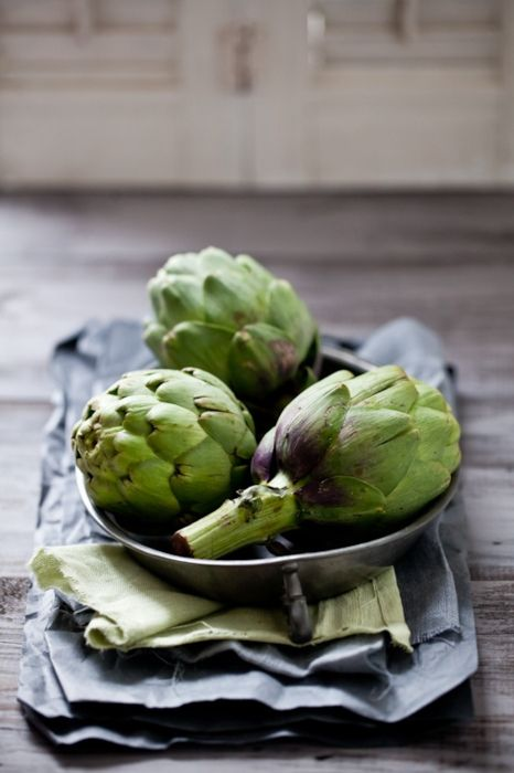 my #1 favorite food, artichokes! my mom taught me to just boil them in water until the outside leaves peel off easily, then work your way in to the best part, the center hearts. no need to add loads of cream/butter and process this veggie into dip, artichokes are perfect in natural form.