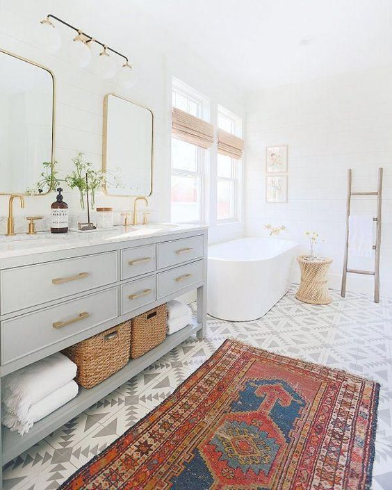 Love this rug and patterned tile in this bathroom
