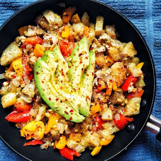 Breakfast Scramble with Peppers, Potato, Onions, and Avocado. Paleo and vegetarian.