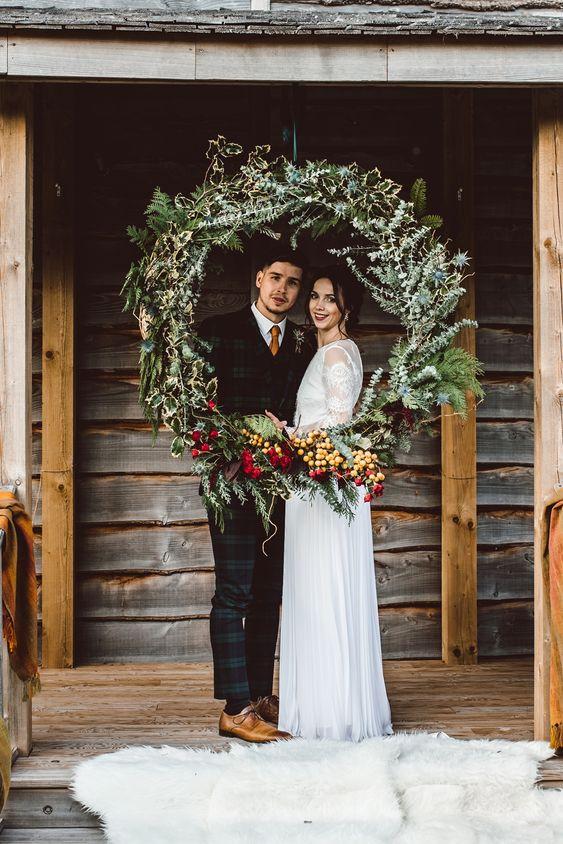 Large Wreath Photo Booth Backdrop Festive Rustic Christmas Wedding Ideas Dhw Photography #Large #Wreath #PhotoBooth #Backdrop #Festive #Rustic #Christmas #Wedding #Ideas