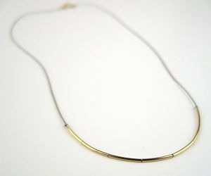 "This necklace spells out ""Mom"" in Morse code dashes. You can also make a custom creation with your own word or phrase.    From $40, coattonline.com"