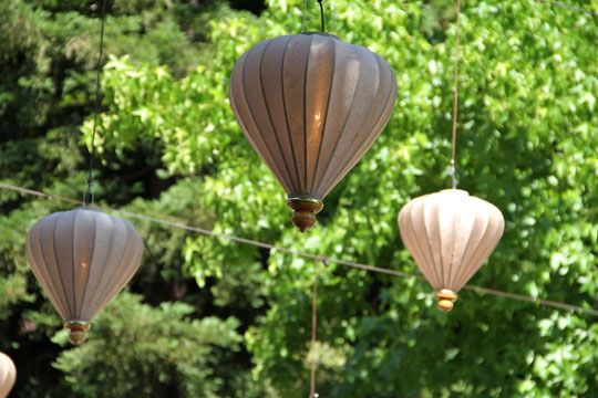Brown suspended balloon lanterns. Outdoor spaces.