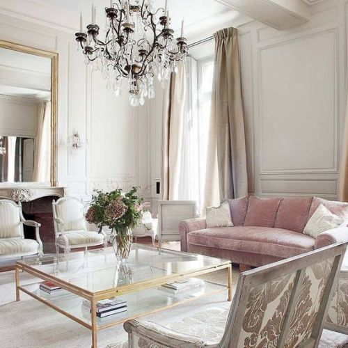Elegant pink velvet sofa in a Parisian living room with classical interior design. Beautiful Classically Refined Rooms.
