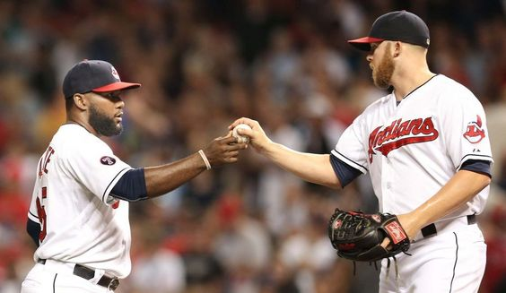 Abraham Almonte, and  Cody Allen, who pitched a 1-2-3 9th inning to close out the Los Angeles Angels, Indians won 3-1, on August 28, 2015 at Progressive Field.  (Chuck Crow/The Plain Dealer)
