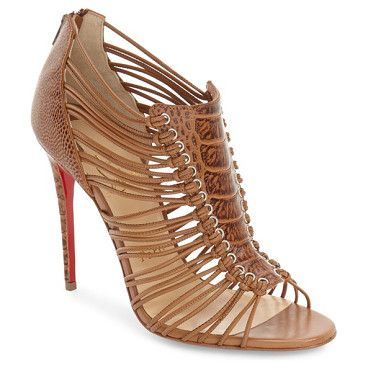 amal ostrich leather sandal by Christian Louboutin. Knotted cord straps secure the embossed shield detail on a gorgeous ostrich-leather sandal handcr...