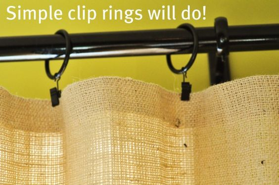No sew burlap curtains, just purchase curtain rod and matching curtain rings. Fold over the raw edge of the material and clamp the ring on, simple and easy!
