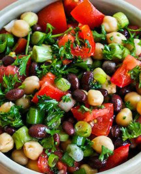 Middle Eastern Bean Salad with Parsley and Lemon.garbanzo beans and black beans, parsley, tomatoes, lemon.