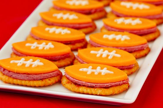 Super Bowl cheese and crackers - (In lieu of a cookie cutter, use the side of a small can for each side of the football.)