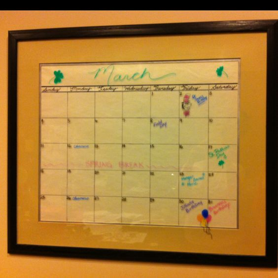 One of my crafty bffs made this... so cute. 10$ 30x34 wall calendar. Pick up a large picture from a thrift store. Draw lines and days of the week on plain white paper. Then use dry erase markers on the glass to write #'s and month. Super easy and cheap!