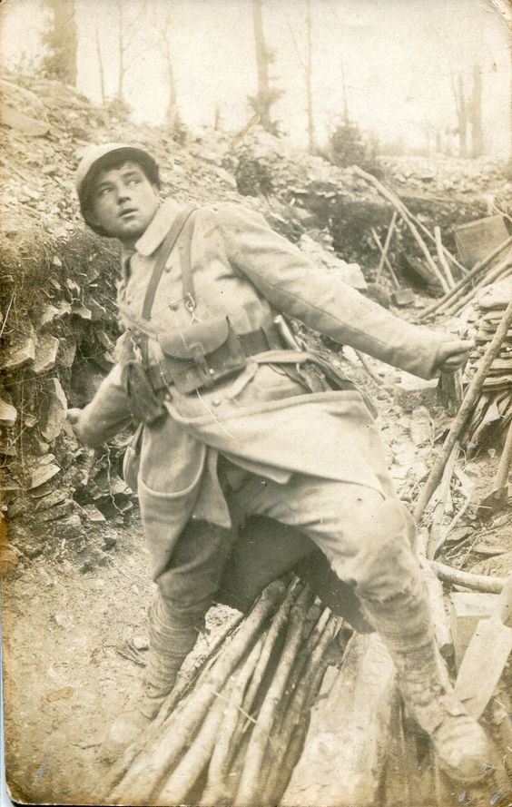 WW1, July 1916; French Poilu in combat gear springing back to throw a grenade…