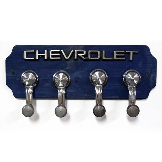 Chevrolet Coat Rack - Chevy Hat Rack with 4 Chrome Car Handle Hooks - Hangers (Why pay $80.00 for this when you can get the window handles & logo of your choice at a used car part's lot. Buy a wooden plack from a craft store or make one your self.)