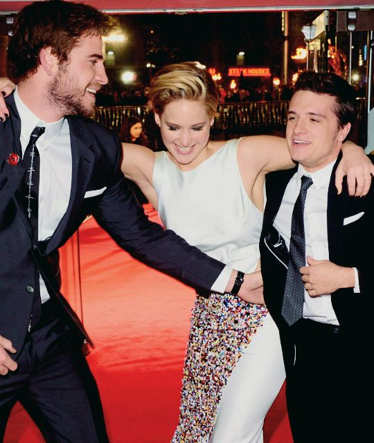Liam Hemsworth, Jennifer Lawrence and Josh Hutcherson at the world premiere of The Hunger Games: Catching Fire in London (11th of November 2013)