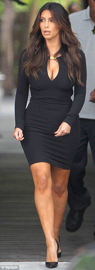 Ok I'll admit it...Im OBSESSED with Keeks!  This body and those clothes are GOAL, GOAL CITY!!  Kim Kardashian takes the plunge in a tight black dress with eye-popping cleavage before slipping into a (slightly) more modest casual ensemble - Kim Kardashian left a photoshoot in Miami on Wednesday in an eye-popping black dress and later changed into white trousers and a silver jacket for sushi with her sisters