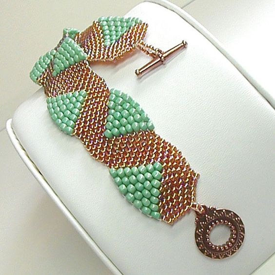 "Peyote stitch using different sized beads: ""Copper Canyon Snake Trail Bracelet by Susan Ivey"":"