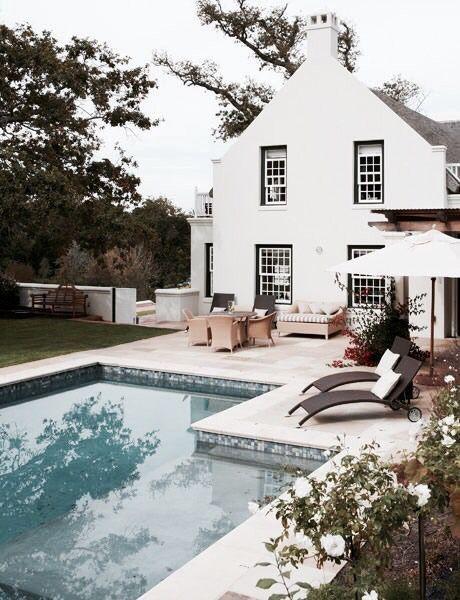 White farmhouse with pool