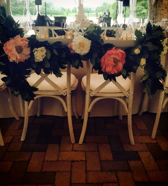 For a garden wedding, decorate chairs with big, beautiful blooms like these ~ JDetailed Events