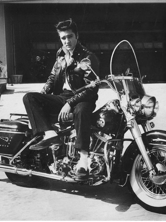 Stud King on a bike. (Aunt Jude better watch it!) :) Elvis---bike: