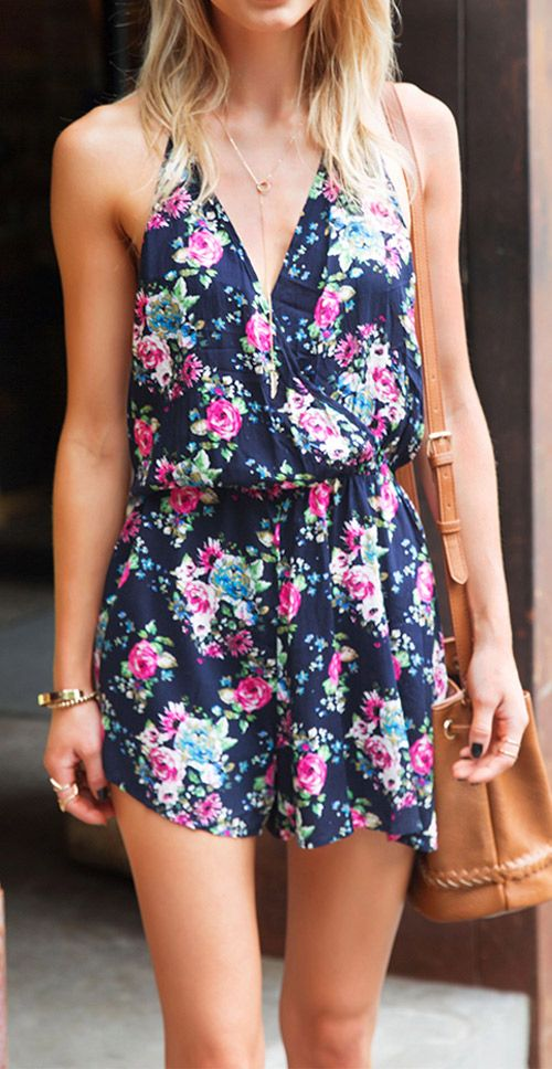 Let the floral romper kill boring time. Catch it now, $15.99! The top is halter design and has a open back to keep you cool and chic! That vibrant floral print just leaps off that black background!: