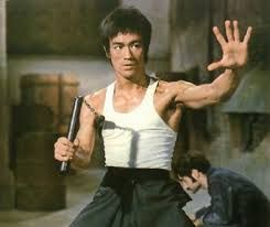 Bruce and his famous weapon nunchaku