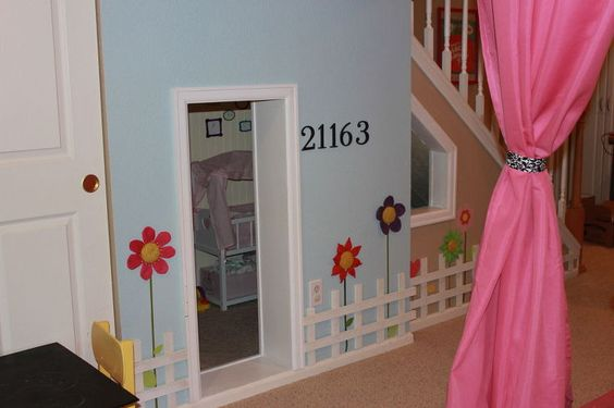basement playroom, basement ideas, home decor, Playhouse under the stairs where the girls keep all their babies