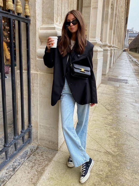 Look com sobreposição com calça jeans