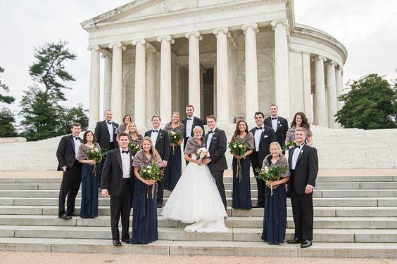 A classy DC wedding.  Bride in gray fur wrap shawl and groom in black-tie tuxedo.  Jefferson Memorial in background.